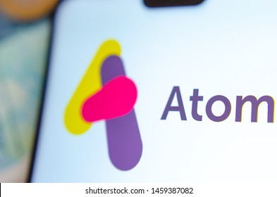 Stone, Staffordshire / UK - July 23 2019:  Macro photo of Atom bank logo on the smartphone screen. Editorial illustrative photo for digital bank Atom.