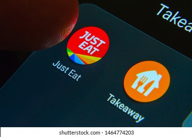 Stone, Staffordshire / UK - July 29 2019: Finger pressing Just Eat app and Takeaway app next to it on the smartphone screen. Conceptual photo for the news about a potential merger of the companies.