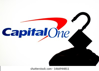 Stone, Staffordshire / UK - July 31 2019:  Capital One Bank logo on the screen in a main focus and a blurred silhouette of the open lock. Conceptual photo for news about the bank data breach.