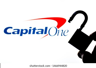 Stone, Staffordshire / UK - July 31 2019:  Capital One Bank logo on the blurred screen and a silhouette of the opened lock in a main focus. Conceptual photo for news about the data breach.