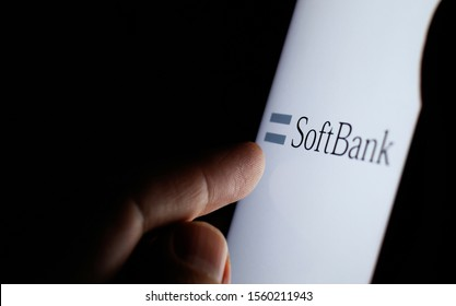 Stone, Staffordshire / UK - November 14 2019: SoftBank logo on a white screen in a dark room and finger touching the screen.