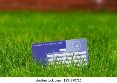 Stone, Staffordshire / UK - October 13 2019: European Health Insurance Card on the grass. Issued by NHS. The EHIC card covers you against illness or injury in Europe.