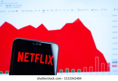 Stone, Staffordshire / UK - September 24 2019: Netflix logo on the smartphone screen and the chart with share (NFLX) price for the last month at the blurred background. Netflix stock falls again.