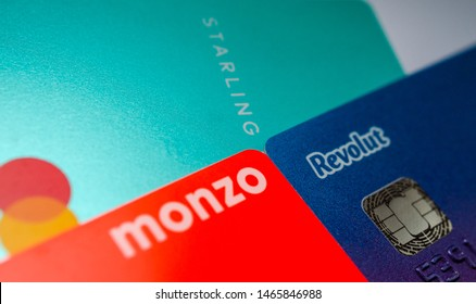 Stone, Staffordshire / United Kingdom - July 30 2019: Close up photo of virtual bank cards: Monzo, Revolut, Starling Bank. Conceptual for competition on the UK fin tech market.