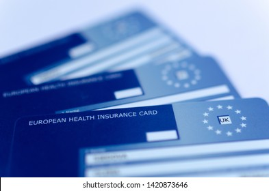 Stone, Staffordshire / United Kingdom - June 10 2019: Macro photo of three  European Health Insurance Cards. The EHIC Card from the NHS covers you against illness or injury when abroad.