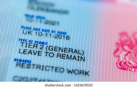 Stone, Staffordshire / United Kingdom - June 13 2019: Macro photo of Biometrical Residence Permit (BRP) cards issued for Tier 2 work visa. BRP gives official right to study or work in the UK.