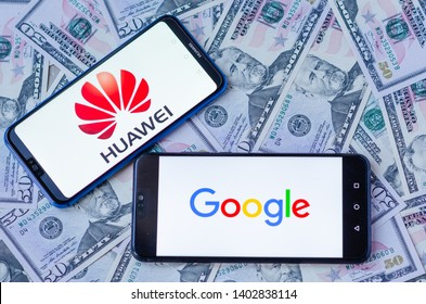 Stone, Staffordshire / United Kingdom -May 20, 2019: The close up photo of two mobile phones on dollars with HUAWEI and Google logos. The conceptual editorial photo shows US-China tensions.