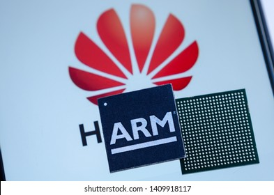 Stone, Staffordshire / United Kingdom - May 28 2019: HUAWEI - ARM = HARM.  Conceptual photo of Huawei logo on a  screen and ARM microchips on top. Illustrates US ban to use ARM in Huawei smartphones.