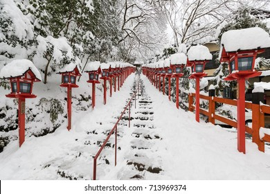 Stone stair and traditional light pole with snow fall in winter at Kifune shrine , Kyoto prefecture , Japan