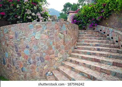 Stone staircase, up and down, textured background,Natural stone stairs landscaping in home garden.