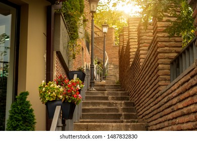 A stone staircase with a narrow aisle leading up