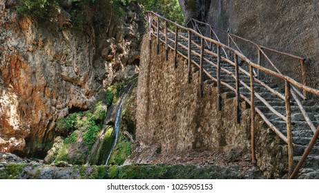 Stone staircase near waterwall in the beautiful butterfly park at Rhodes island, Greece