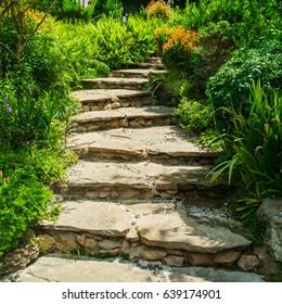 A stone staircase through a park.