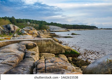 Stone stairs for boat docking between the coastal rocks of Cabalo Point in Arousa Island