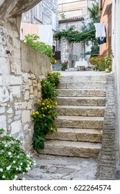 Stone stairs in front yard of old Mediterranean town in Croatia