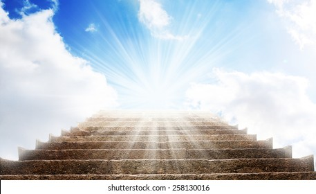 stone stairs, like a path to the blue sky and white clouds, with sunlight shining, like a ladder to the heaven