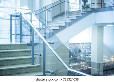 stone Stairs in modern interior. glass railing.