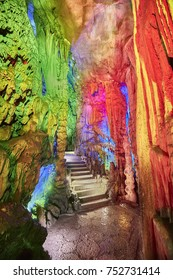 Stone stairs in Reed Flute Cave, natural limestone cave with multicolored lighting in Guilin, Guangxi, China.