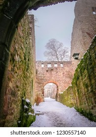 Stone stairs under the snow at the Baden-baden ruins of the Middle Ages old castle Altes Schloss Hohenbaden in the Black Forest of the Baden-Wurttemberg region in the southwest of Germany
