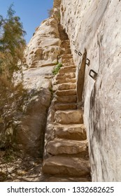stone stairway carved into the side of the cliff of the nahal zin ein avdat canyon in the negev desert in israel