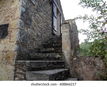 Stone stairway leading into Chateau De Bonaguil. Ancient castle ruins, France.