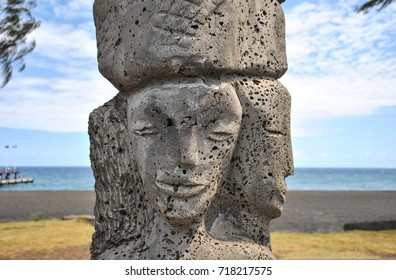 Stone statue, black sand beach, Reunion Island, France