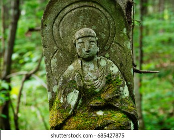 stone statue in forest