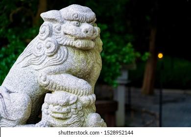 A stone statue of a guardian dog at Kinomiya Shrine