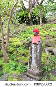 Stone statue of Jizo (Jizo Bosatsu, Ksitigarbha) in a knitted hat, Miyajima, Japan