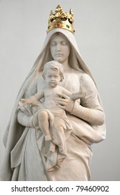 Stone statue of Madonna with Child