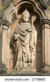 A stone statue of Saint Augustine as found on Lichfield Cathedral.