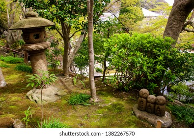 Stone statue of three smiling Jizo (Nagomi Jizo), Hasedera temple, Kamakura, Japan
