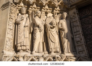 Stone statues at the entrance of Notre-Dame Cathedral in Paris, France