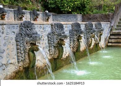 Stone statues spewing sulfur water in Banjar Hot Springs (Singaraja, Indonesia).