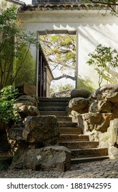 stone step and the bricks wall, a quiet path in the garden. traditional suzhou style garden.