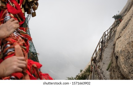 Stone steps cut on a side of a mountain rock leading to the dangerous and perilous Plank Walk trail, closed for public access due to bad weather conditions, Huashan mountain, Shaanxi Province, China