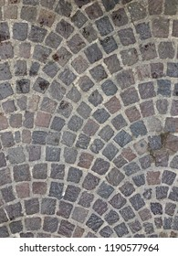 Stone street cobblestone pavement from old Paris in France