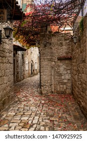 Stone street of Trogir city with leaves on the ground