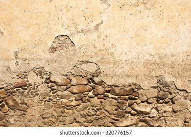 Stone and stucco texture on decayed wall in San Miguel de Allende Mexico