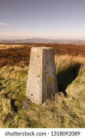 Stone summit marker or trig point on Cyrn y Brain mountain North Wales these mark summits of hills and mountains in the UK
