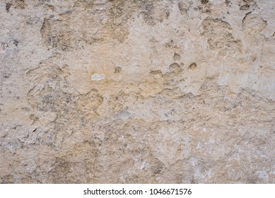 Stone surface of a dark yellow sandstone - background, texture