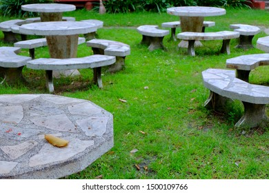 Stone table and chairs outdoor seating area