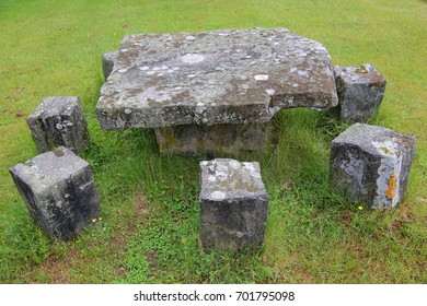 Stone table on a green grass ground.