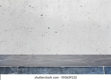 Stone table top and background of grey old concrete wall - can used for display or montage your products.