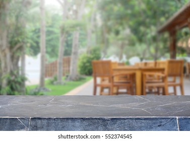 Stone table top and blurred garden background with vintage filter - can used for display or montage your products.