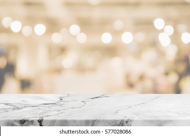 Stone table top and blurred restaurant interior background with vintage filter - can used for display or montage your products.