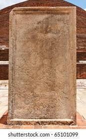 Stone tablet with inscriptions at Jetavaranama dagoba  (stupa). Anuradhapura, Sri Lanka