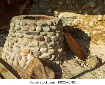 Stone Tandoor — oven-brazier, grill special spherical or pitcher type for cooking a variety of food among the peoples of Asia.
