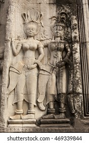 Stone temple carvings showing intricate details reaming after years of weathering due to environmental conditions.