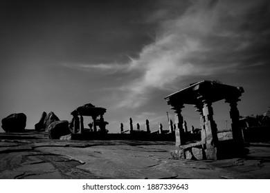 Stone temple structures amidst granite boulders on Hemakuta Hill in Hampi, Karnataka, India